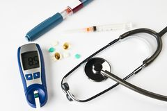 Medicine, diabetes, glycemia, health care concept. Medical stethoscope, device for measuring blood sugar level, glucose meter, insulin syringe pen, lancet,test royalty free stock images