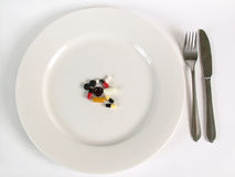Medicine for dinner Stock Images