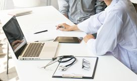 medicine doctor explain diagnosis to doctor team holding and showing clipboard exploring important document. royalty free stock images