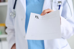 Medicine doctor hand giving prescription Stock Images