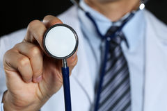 Medicine doctor hand hold stethoscope head Royalty Free Stock Photo