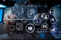 Medicine doctor hand working with modern computer interface as m. E-learning with connected gear cogs connected diagram virtual dashboard.Medicine doctor hand Stock Images