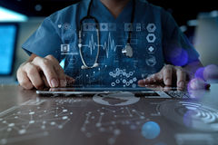Medicine doctor hand working with modern computer interface as m Royalty Free Stock Images