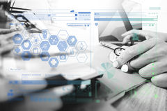 Medicine doctor hand working with modern digital tablet and lapt Royalty Free Stock Photo