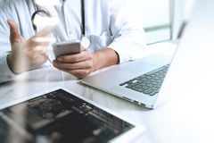 Medicine doctor hand working with modern digital tablet and lapt Stock Photo