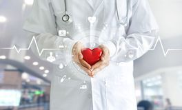 Free Medicine Doctor Holding Red Heart Shape In Hand And Icon Medical Royalty Free Stock Image - 99680226