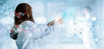Medicine doctor holding virtual interface and medical analysis on hologram modern screen, report record. DNA. Digital healthcare. And network connection royalty free stock image