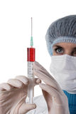 Medicine doctor with medical syringe in hands Royalty Free Stock Photography