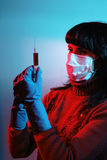 Medicine doctor with medical syringe in hands Royalty Free Stock Images