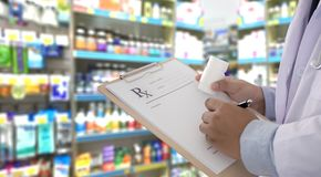 Medicine doctor patient healthcare concept contraception Rx pre. Scription form in drug store Pharmacist pharmacy stock photos