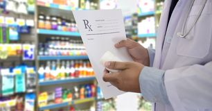 Medicine doctor patient healthcare concept contraception Rx pre. Scription form in drug store Pharmacist pharmacy royalty free stock image