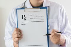 Medicine doctor patient healthcare concept contraception Rx pres. Cription form in drug store Pharmacist pharmacy stock photography