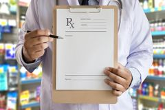 Medicine doctor patient healthcare concept contraception Rx pre. Scription form in drug store Pharmacist pharmacy stock photo