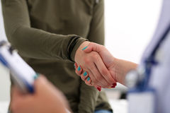 Medicine doctor shake hands as hello with female patient Stock Photo