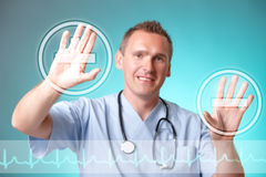Medicine doctor working with futuristic interface. He chooses plus and minus symbols to do cardiac test for his patient. EKG line on the bottom of the screen Stock Photography