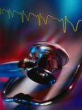 Medicine - Doctors Stethoscope and Heart Trace. A doctors stethoscope and Electrocardiograph trace of the heartbeat. A stethoscope is a medical instrument for royalty free stock images