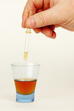 A medicine dropper in hand. Royalty Free Stock Photography