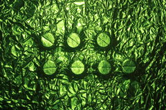 Medicine green tablets print background texture Stock Photo