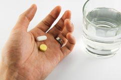 Medicine in hand with water Stock Photography