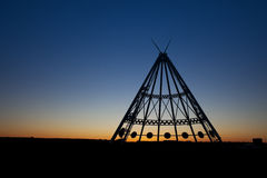 Medicine Hat Teepee at Sunset. The worlds largest teepee is located in Medicine Hat, Alberta, Canada.   Originally constructed for the Calgary 1988 Winter Stock Photo