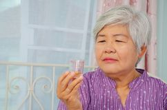 Free Medicine, Health Care And People Concept - Senior Woman Looking At Jars With Medicine  In Her Hand At Home Or Hospital Office Royalty Free Stock Image - 160971566