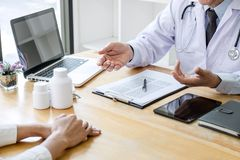 Medicine and health care concept, Professor Doctor presenting report of diagnosis and recommend something a method with patient. Treatment, after results about royalty free stock photo