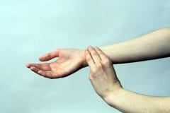 Medicine health care. Female hand checking pulse on wrist Stock Image