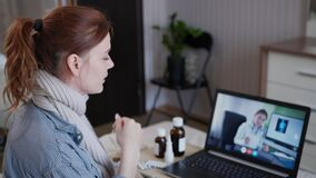 Medicine and health, female patient consults about treatment status with doctor online shows medications