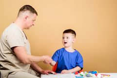 Medicine and health. happy child with father with stethoscope. father and son in medical uniform. small boy with dad in. Hospital. family doctor. trust and stock image
