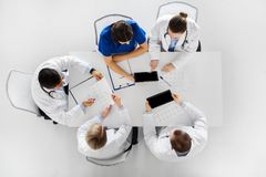 Doctors with cardiograms and tablet pc at hospital Stock Photography