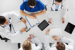 Group of doctors with cardiograms at hospital Stock Photo