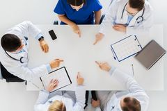 Group of doctors with cardiograms working at table Royalty Free Stock Photography