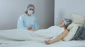Medicine and healthcare concept. a doctor is caring for a patient in a hospital. The doctor informs the patient that she
