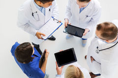Doctors with cardiogram and and tablet pc Stock Photo