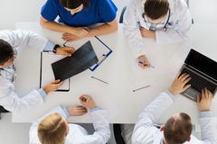 Group of doctors with x-ray and laptop at clinic Royalty Free Stock Photography