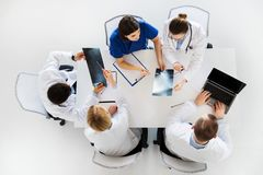 Group of doctors with x-rays and laptop at clinic Royalty Free Stock Image