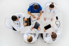 Doctors with x-ray and cardiogram at hospital Royalty Free Stock Photography