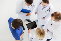 Doctors with tablet pc at hospital Royalty Free Stock Photo