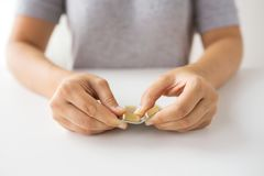 Woman hands opening pack of medicine capsules. Medicine, healthcare and people concept - woman hands opening pack of cod liver oil capsules royalty free stock images
