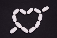 Medicine heart pills Stock Photography