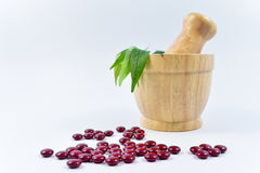 Medicine and Herbal in Wooden Mortar on white Background. Medicine pill and Herbal in Wooden Mortar on white Background Stock Photo
