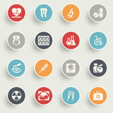 Medicine icons with color buttons on gray background. Royalty Free Stock Photos