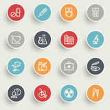 Medicine icons with color buttons on gray background. Stock Image