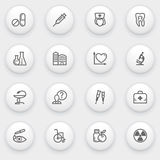 Medicine icons with white buttons on gray backgrou Royalty Free Stock Photography