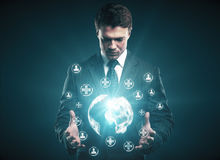 Medicine and innovation concept. Handsome businessman holding polygonal globe with abstract glowing medical icons on dark background. Medicine and innovation Vector Illustration