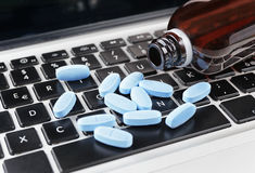 Medicine on keyboard royalty free stock image