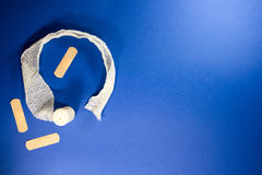 Medicine kit gauze and bandage on a blue background. As a help and first aid Royalty Free Stock Images