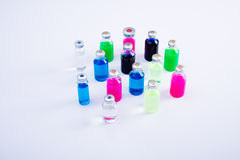 Medicine laboratory. Little bottles with medicine in different colors Royalty Free Stock Images