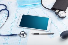 Medicine and modern technology concept with copyspace on tablet. Medicine and modern technology concept with diagnostics concept with free space on tablet royalty free stock photo