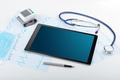 Medicine and modern technology concept with copyspace on tablet. Medicine and modern technology concept with diagnostics concept with free space on tablet royalty free stock images